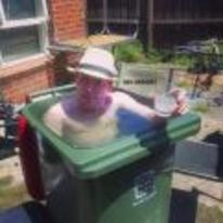 Radnom funny picture tags: UK summer guy bin filled-with-water