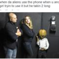 Radnom funny picture tags: black-twitter alien phone girl-trying-to-use-it wont-get-off