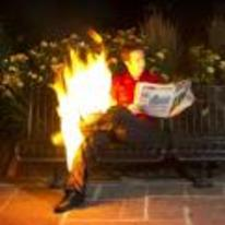 Radnom funny picture tags: guy sitting bench reading-paper on-fire