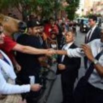 Radnom funny picture tags: horse-head mask shaking obama hand