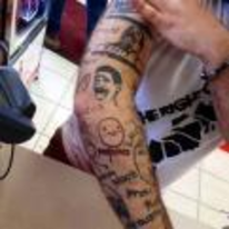 Radnom funny picture tags: meme tattoo awful arm forever-alone