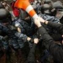 Radnom funny picture tags: protestor-helps-police-install-vlc police riot traffic-cone vLC