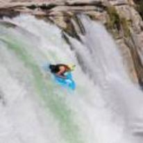 Radnom funny picture tags: ridding inflatable dolphin over waterfall