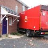 Radnom funny picture tags: royal-mail delivery crash house wall