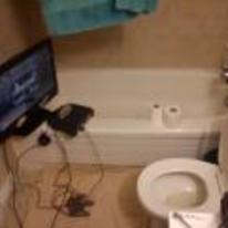 Radnom funny picture tags: toilet-gaming n64 TV bath toilet