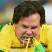 Radnom funny picture tags: world-cup-2014 angry-brazil-fan eating flag germany